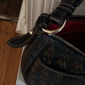 Authentic Dooney & Bourke 1975 hand bag.